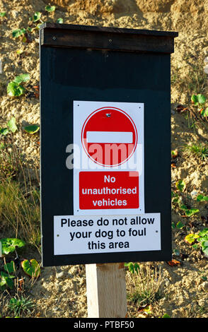 A notice indicating No Unauthorised Vehicles and No Dog Fouling at the base of the beach access at West Runton, Norfolk, England, UK, Europe. - Stock Image
