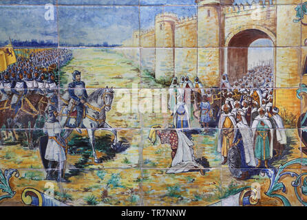 Conquest of city of Badajoz to the moors by king Alfonso IX of Leon, 1230. Reconquista. Glazed tile. Spain Square. Seville. Spain. - Stock Image
