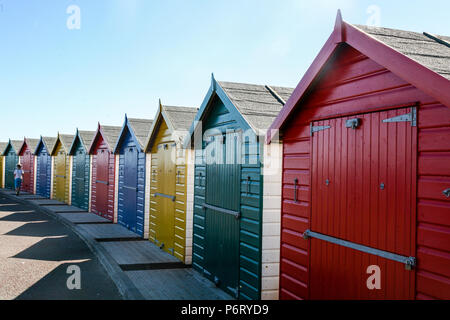Colourfully painted beach huts in Dawlish on a bright and sunny day, Devon, England, Europe. - Stock Image