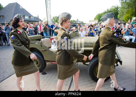 ENSCHEDE, THE NETHERLANDS - 01 SEPT, 2018: The three singers from 'Sgt. Wilson's army show' marching to the stage during a military army show. - Stock Image