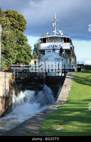 The old passenger ship M/S, Juno IMO 8634132, passing lock of Göta Canal, Sweden. - Stock Image