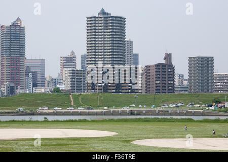 open air park baseball field river apartments - Stock Image