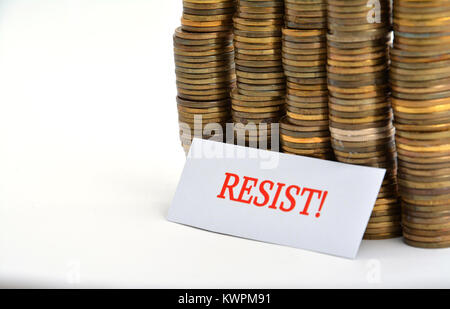 Word resist with coins isolated on white background - Stock Image