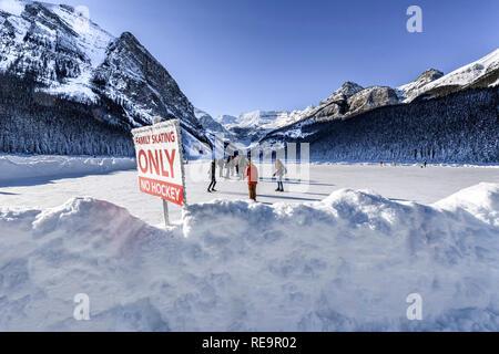 Winter ice skating at Lake Louise, Banff Alberta Canada - Stock Image