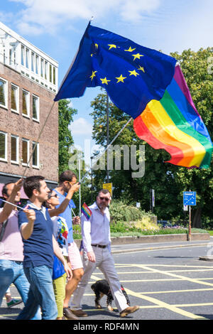 Man waving the EU and Rainbow flag during an event in Southampton, England, UK - Stock Image