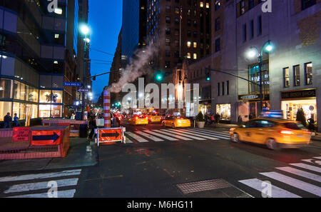 steam leak coming out a temporary chimney at a busy midtown street in Manhattan - Stock Image