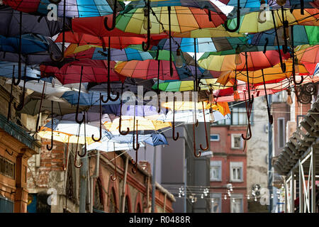 Flying multicoloured umbrellas in Karakoy street. Istanbul. Turkey - Stock Image
