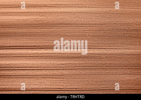 Plowed agricultural field aerial top view. Soil background and texture - Stock Image