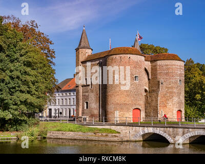 25 September 2018: Bruges, Belgium - The Gentpoort or Ghent Gate, a 15th Century part of the city's defences. - Stock Image