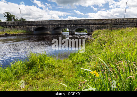 Border Crossing, Belcoo-Blacklion, Ireland. A beautiful bridge over the Belcoo River links Belcoo in County Fermanagh, Northern Ireland to Blacklion i - Stock Image
