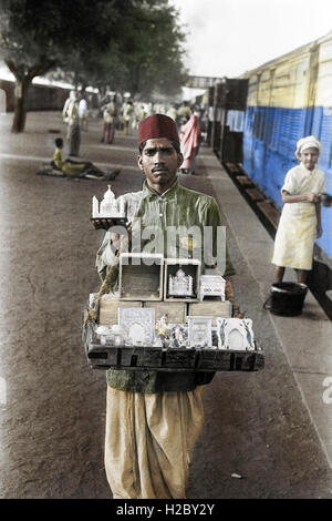 Souvenir seller on the platform of Agra railway station in1943 - Stock Image
