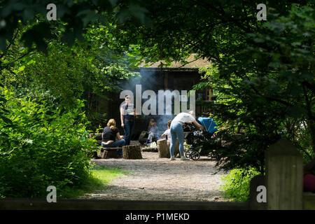 mother and child adventure area with barbeque - Stock Image