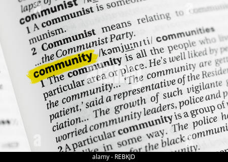 Highlighted English word 'community' and its definition at the dictionary. - Stock Image