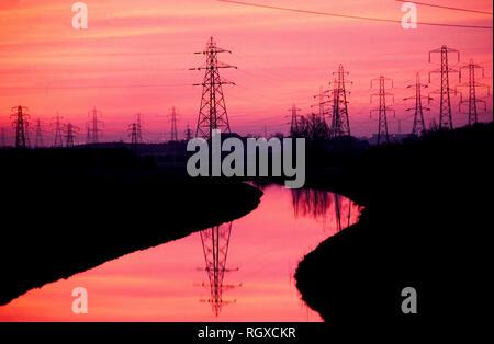 Electricity Pylons on Rainham Marshes, Essex, England UK, 1980 Dusk - Stock Image