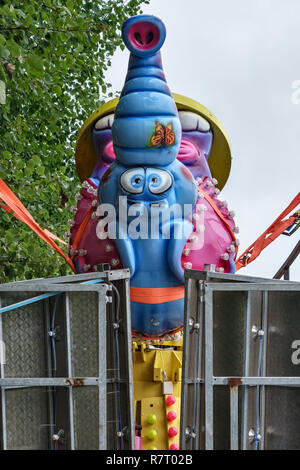 UK. A lorry transporting a fairground ride featuring Dumbo, Walt Disney's flying elephant - Stock Image