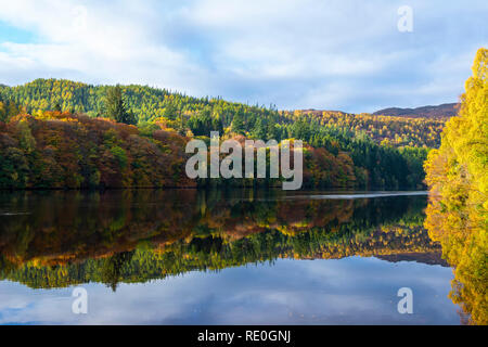 Autumn reflections on Loch Faskally near Pitlochry, Perthshire, Scotland - Stock Image