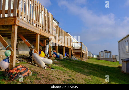 Holiday homes overlooking the cliffs near Hive beach at Burton Bradstock in West Dorset UK - Stock Image