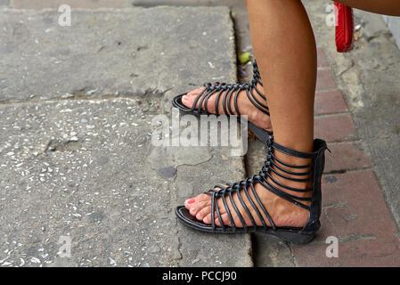 Woman wearing gladiator sandals - Stock Image