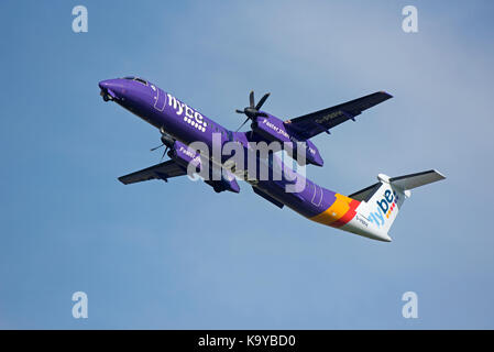 Bombardier Dash 8 Q400 on daily schedule to Inverness Scotland. - Stock Image