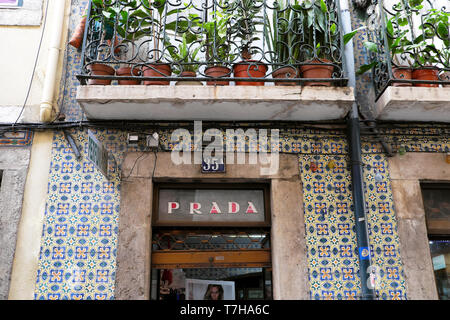 Prada sign above a womens boutique shop with traditional tiles on Rua da Boavista street in Lisbon Portugal Europe EU  KATHY DEWITT - Stock Image