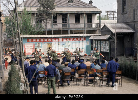 China during the Cultural Revolution  Mao Tse-tung's thought propaganda team of workers performing a presentation to the employees - Stock Image