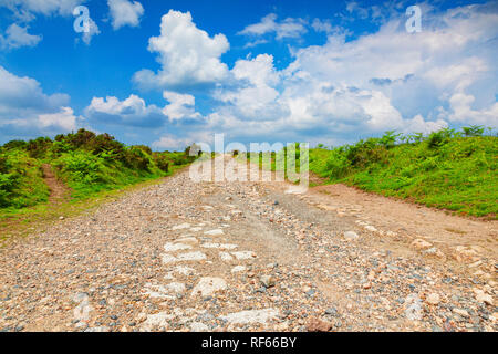 Gravel Road on Bodmin Moor, Cornwall, UK. The moor has been used as a location for the filming of the TV serial Poldark. - Stock Image