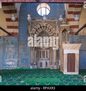 Blue, Iznik ceramic tiles wall with engraved Mihrab (niche) and decorated marble Minbar (Platform) at the Mosque of Aqsunqur (Blue Mosque), Cairo, Egy - Stock Image