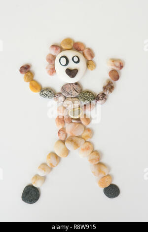natural art, craft, picture of person, made from pebbles, shells, - Stock Image