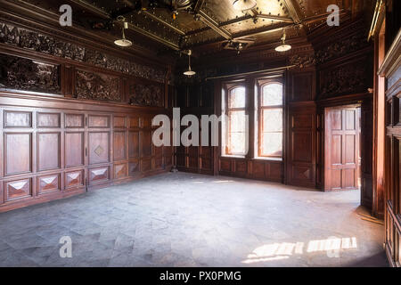 Interior view of room with wooden paneling in an abandoned palace in Poland. - Stock Image
