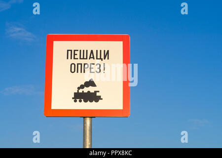 "Train warning sign in the Cyrillic alphabet in Belgrade, Serbia. ""Pedestrians, be aware of the train"". - Stock Image"