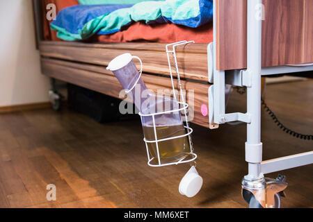Urine bottle at nursing bed - Stock Image