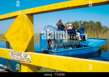 Everglades Florida Tamiami Trail USigertail's Gator Airboat Rides Beware of Attack Alligator sign - Stock Image