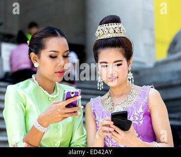 Thai women wearing traditional attire - Stock Image