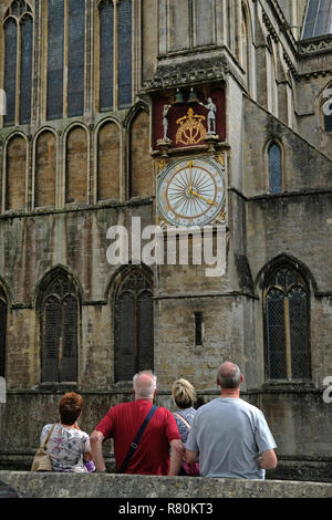 Tourists waiting for the knights to strike the bells on the Wells Cathedral​ clock in Somerset. - Stock Image