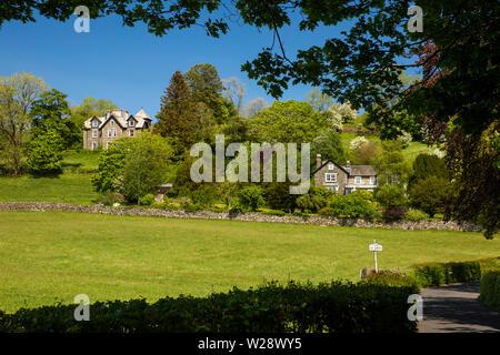 UK, Cumbria, Hawkshead, Far Sawrey, Victorian houses on Cuckoo Brow Lane below Penny Brow Wood - Stock Image