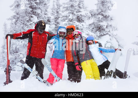 Happy adult friends skiers winter - Stock Image