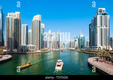 DUBAI, UAE - FEBRUARY 26, 2019: Dubai Marina is an artificial canal city and a district in Dubai in UAE - Stock Image