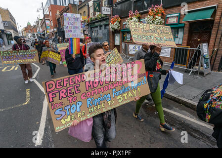 London, UK. 8th September 2018. A march goes through Brixton calling for the Windrush scheme to be widened to include all families and descendants of the Windrush Generation and for an end to the racist hostile environment for all immigrants. It demanded an amnesty for those living here without secure immigration status and for free movement for Commonwealth Citizens. Credit: Peter Marshall/Alamy Live News - Stock Image