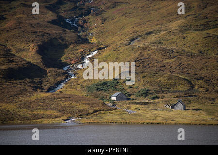 Buildings on the far side of Loch Merkland, Sutherland, Scotland, UK - Stock Image