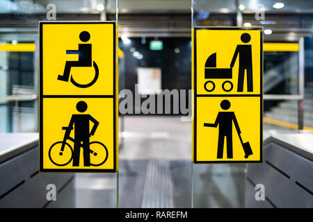 handicapped, bicycle, stroller and big luggage yellow pictrogram in metro, information in public transport, no people - Stock Image