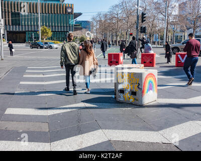 Anti terrorism bollards decorated with same sex marriage messages in South Bank, Melbourne, Australia - Stock Image