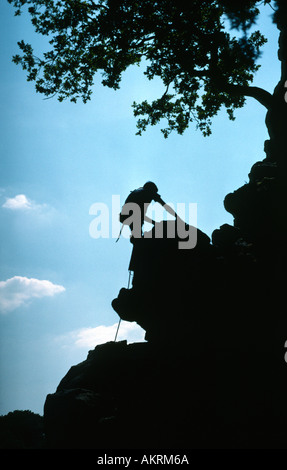 Shilouette of a rock climber eak District National Park, Derbyshire - Stock Image