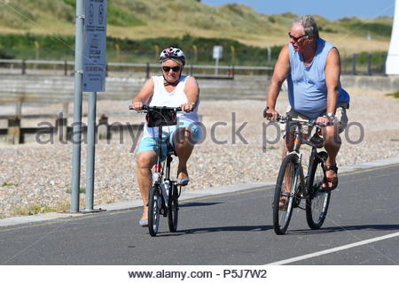 Littlehampton, UK. Wednesday 27th June 2018. People cycle along the promenade on another very warm and sunny morning in Littlehampton, on the South Coast. Credit: Geoff Smith / Alamy Live News. - Stock Image