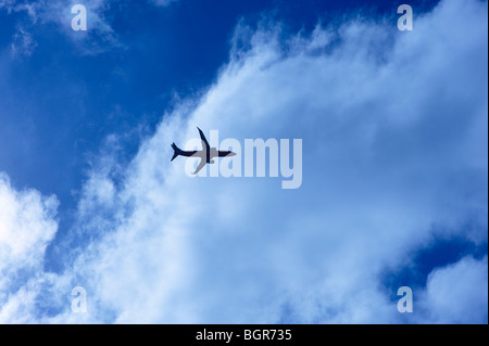 Airliner flying into clouds - Stock Image