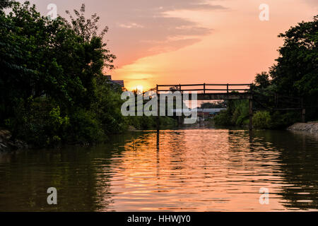 Landscape small canals, water is used as a thoroughfare rural and old wooden bridge for crossing the water during - Stock Image