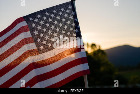 Sunset behind a mini-flag in the Virginia mountains - Stock Image
