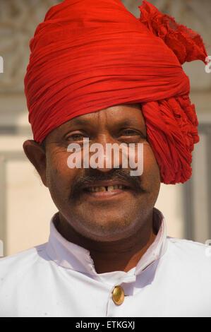 Rajasthani man in red turban. Palace of Jaipur, Jaipur, Rajasthan, India - Stock Image