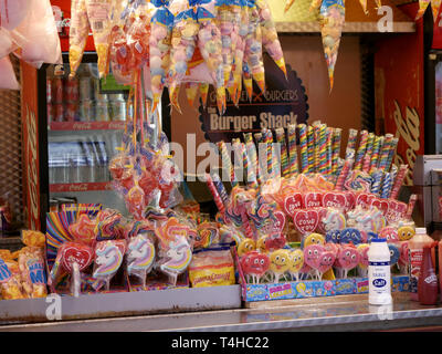 Stall at the funfair selling all sorts of sweet treats - Stock Image