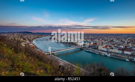 Budapest, Hungary - Aerial panoramic skyline of Budapest at sunrise with Elisabeth Bridge (Erzsebet Hid), Szechenyi Chain Bridge, Parliament and cruis - Stock Image