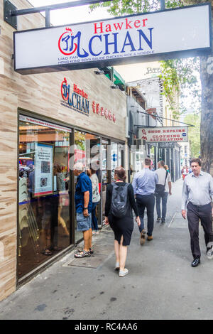 Melbourne, Australia - 21st February 2018: People walking past a Hawker Chan restaurant. The original in Singapore has a Michelin one star. - Stock Image